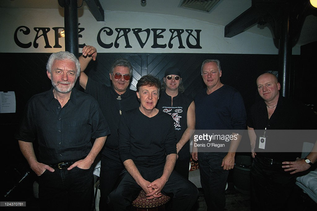 Paul McCartney with his all-star band before their concert at the Cavern Club, Liverpool, 14th December 1999. Left to right: keyboard player Pete Wingfield, guitarist Mick Green, Paul McCartney, drummer Ian Paice, guitarist David Gilmour and cajun accordionist Chris Hall.