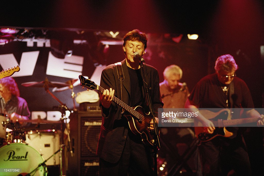 Paul McCartney and his all-star band rehearsing for their concert at the Cavern Club, Liverpool, 14th December 1999. From centre: McCartney, Pete Wingfield and Mick Green.