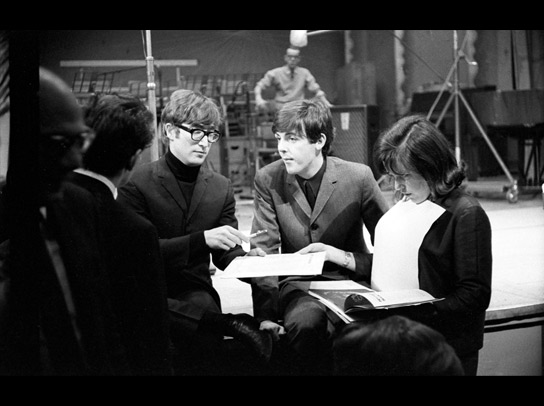 John Lennon and Paul McCartney talk with production staff of the radio pop music programme 'Saturday Club' in December 1963. The inspiration for their early work came from the sounds of their youth: music hall, blues, skiffle, soul and rock 'n' roll.