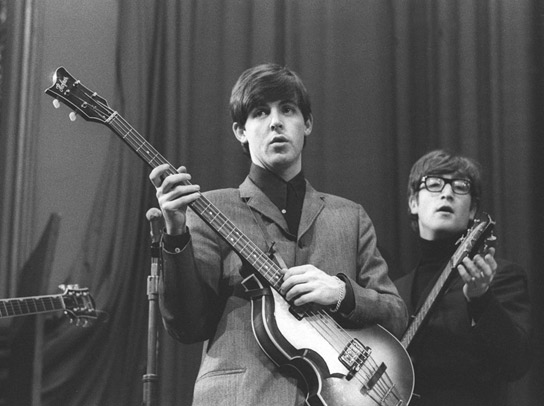 Paul McCartney with his Hofner bass guitar during the recording of 'Saturday Club' in December 1963. When bassist Stuart Sutcliffe left the band in 1961, McCartney took over his role, in addition to piano and vocals.