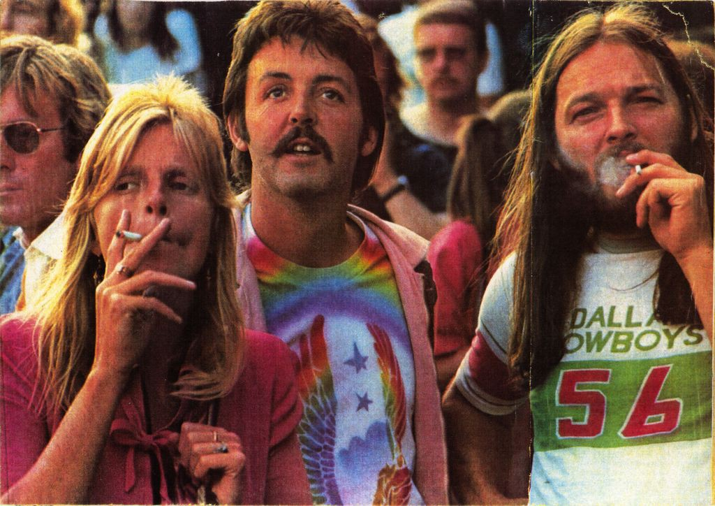 Photo of Linda McCartney, Paul McCartney and Pink Floyd's David Gilmour taken at UK's Knebworth Fair in 1976 which was headlined by The Rolling Stones
