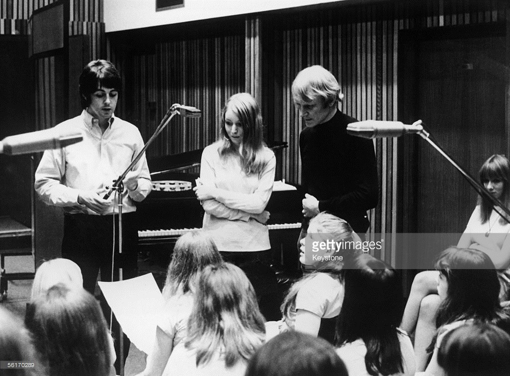 From left to right, Paul McCartney, Mary Hopkin and arranger Richard Newson enlist the aid of the Aida Foster Children's Choir to record Hopkin's song 'Those Were the Days' for the Apple label, 26th July 1968.