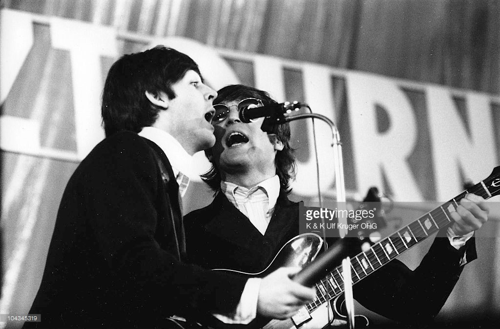 Paul McCartney and John Lennon of the Beatles perform on stage at Ernst Merck Halle on their final German tour (the Bravo-Beatles-Blitztournee) on 26th June 1966 in Hamburg, Germany - Credits : K & K Ulf Kruger OHG
