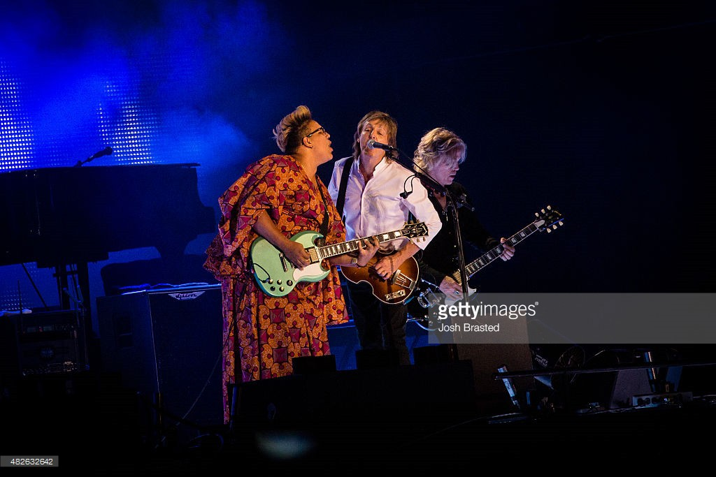 Brittany Howard (L) joins Paul McCartney (C) on stage at the 2015 Lollapalooza music festival at Grant Park on July 31, 2015 in Chicago, Illinois.