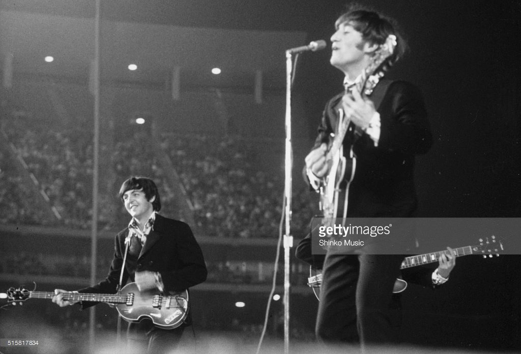Paul McCartney and John Lennon of The Beatles live at Dodger Stadium, Los Angeles, California, August 28, 1966.