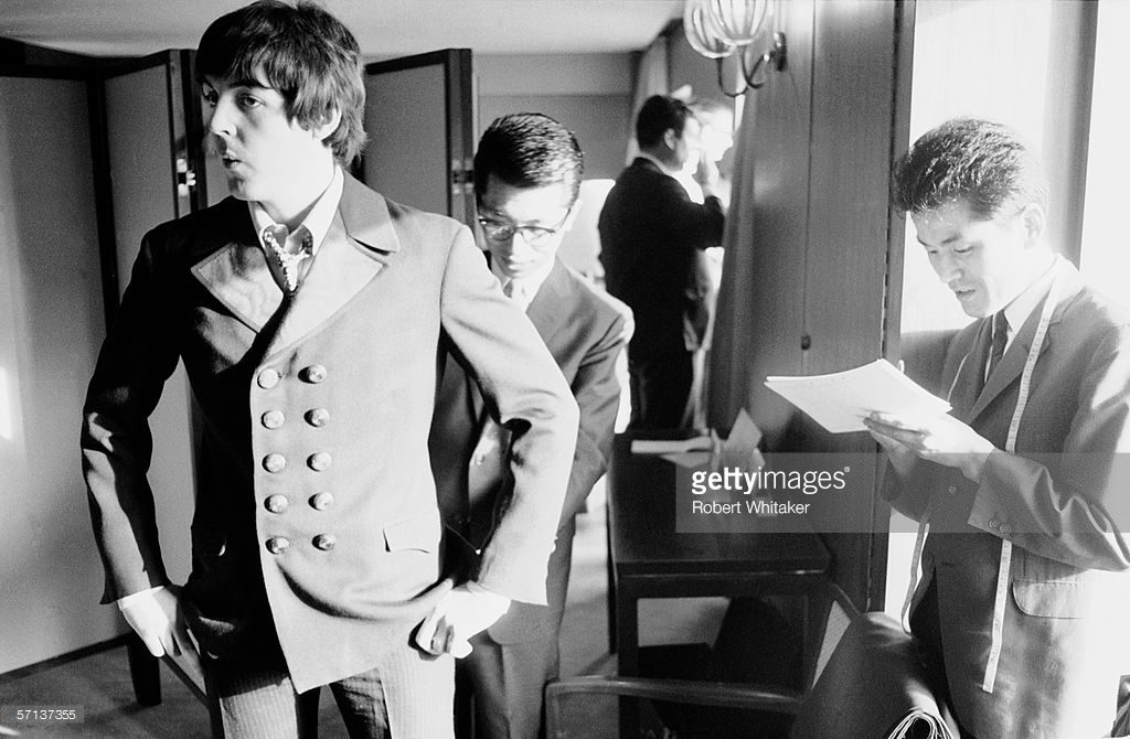 Paul McCartney  has his suit taken out by a tailor at the Tokyo Hilton during the  Beatles' Asian tour, 30th June 1966