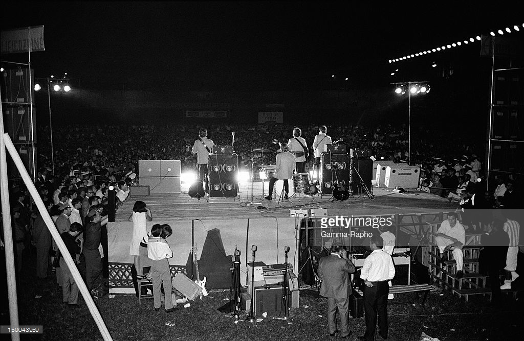The Beatles on stage on June 28, 1965 in Rome, Italy. Credits: Reporters Associés