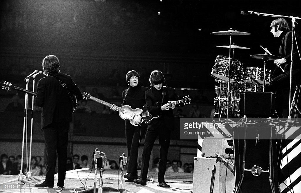 Photo of BEATLES, L-R. John Lennon, Paul McCartney, George Harrison (with Gibson SG guitar), Ringo Starr performing live onstage at NME Poll Winners concert - Credits: Cummings Archives