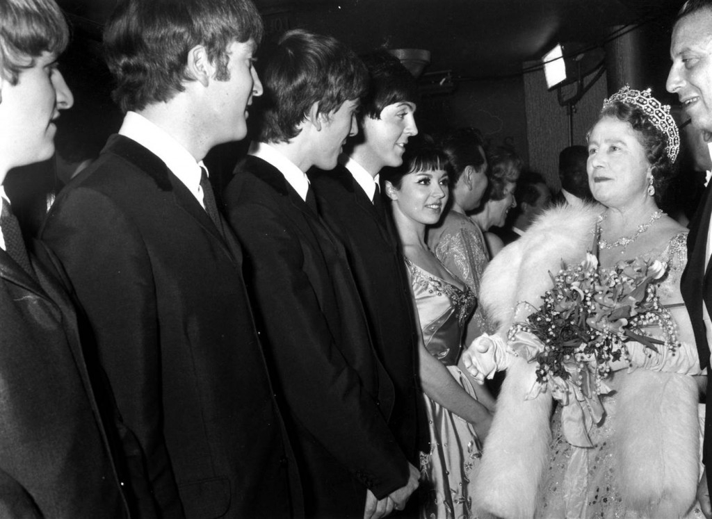 November 4, 1963: The Queen Mother talks to the Beatles after a Royal Variety Show at the Prince of Wales Theatre in London. George Freston / Fox Photos via Getty Images