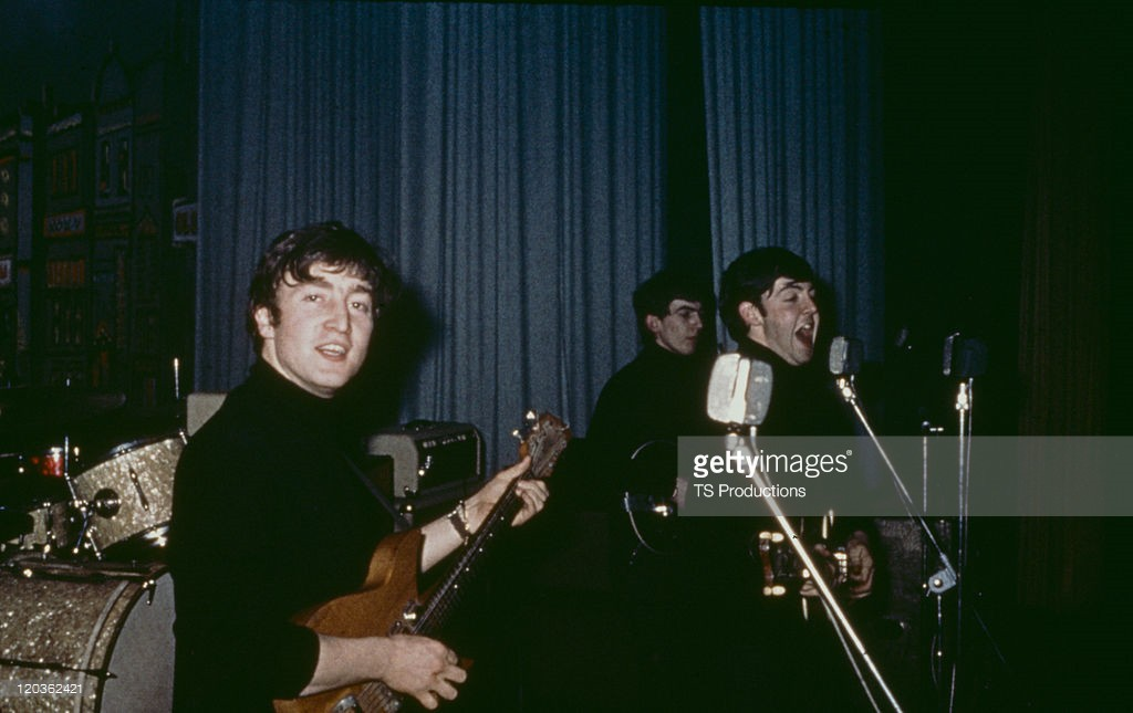 The Beatles performing on stage at the Star Club, Hamburg, April-May 1962. Left to right: John Lennon (1940 - 1980), George Harrison (1943 - 2001) and Paul McCartney - Credits : TS Productions