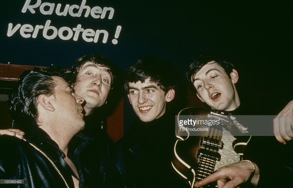 American rock and roll musician Gene Vincent (1935 - 1971) with The Beatles at the Star Club, Hamburg, April-May 1962. Left to right: Vincent, John Lennon (1940 - 1980), George Harrison (1943 - 2001) and Paul McCartney - Crédits : TS Productions