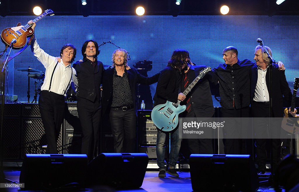 Honoree Sir Paul McCartney, Rusty Anderson, Brian Ray, Dave Grohl, Abe Laboriel Jr., Paul (Wix) Wickens and Joe Walsh perform onstage during The 2012 MusiCares Person of The Year Gala Honoring Paul McCartney at Los Angeles Convention Center on February 10, 2012 in Los Angeles, California.